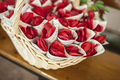 Basket full of cornets filled with red rose for wedding Royalty Free Stock Photo