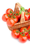 Basket full of delicious tomatoes Stock Photo