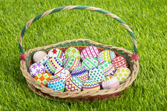 Basket full of easter eggs Royalty Free Stock Photos