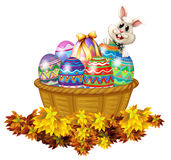 A basket full of Easter eggs and a bunny Royalty Free Stock Photography