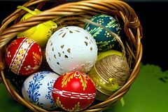 Basket full of Easter eggs for the Easter celebration happy. Stunning beautiful carved and painted Easter eggs of different colors. Christian tradition during Royalty Free Stock Photos