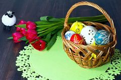 Basket full of Easter eggs for the Easter celebration happy. Stunning beautiful carved and painted Easter eggs of different colors. Christian tradition during Royalty Free Stock Photo