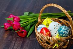 Basket full of Easter eggs for the Easter celebration happy. Stunning beautiful carved and painted Easter eggs of different colors. Christian tradition during Royalty Free Stock Photography