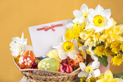 Basket full of Easter eggs and  flowers Stock Images