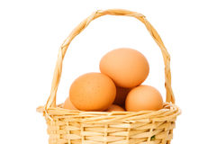 Basket full of eggs isolated Stock Image
