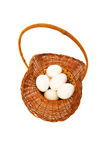 Basket full of eggs isolated Stock Photography