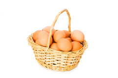 Basket full of eggs isolated Royalty Free Stock Image