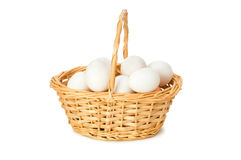 Basket full of eggs isolated Stock Photo