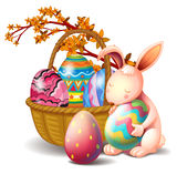 A basket full of eggs and a rabbit Stock Image