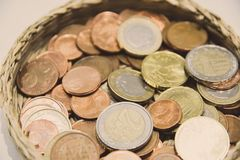 Basket full of euro coins. European Union currency royalty free stock images