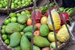 Basket full with exotic fruits in a market Royalty Free Stock Photos