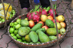 Basket full with exotic fruits in a market Royalty Free Stock Photography