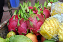 Basket full with exotic fruits in a market Stock Images