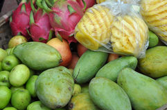 Basket full with exotic fruits in a market Stock Photos
