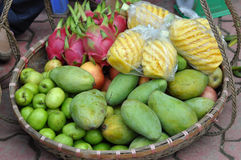 Basket full with exotic fruits in a market royalty free stock image