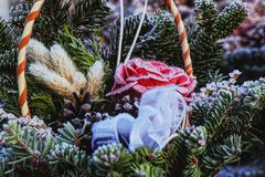 A basket full of flowers and plants grows up in forest. Beautifly gift box on funeral. A basket is covered hoarfrost.  stock images