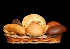Basket full of fresh bread products Stock Images