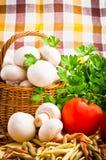 Basket full of fresh champignon mushrooms Stock Photos