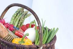 Basket full of fresh organic vegetables Royalty Free Stock Photo
