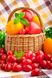 Basket full of fresh tomatoes and cherry tomatoes Royalty Free Stock Photography