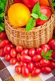 Basket full of fresh tomatoes and cherry tomatoes Royalty Free Stock Images