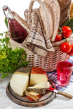 Basket full of fresh vegetables and cheese Royalty Free Stock Images
