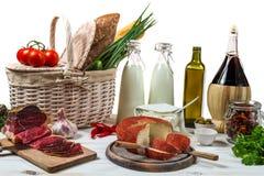 Basket full of fresh vegetables and ham Stock Photo