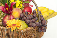 Basket full of fruits and flowers Stock Photos