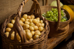 Basket full of grapes and potato at counter Royalty Free Stock Photography