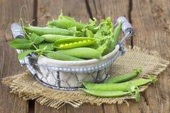 Basket full of green peas Royalty Free Stock Photo