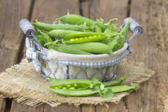 Basket full of green peas Royalty Free Stock Image