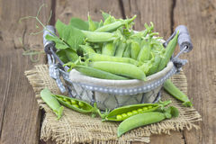 Basket full of green peas Royalty Free Stock Photo