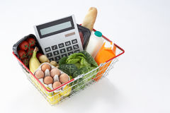 Basket full of groceries and calculator Stock Image
