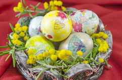 Basket full of handcolored Easter Eggs in decoupage Royalty Free Stock Images