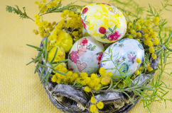 Basket full of handcolored Easter Eggs in decoupage Royalty Free Stock Image