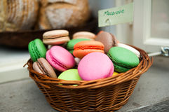 Basket full of macaroons on a cafeteria shelf Stock Images
