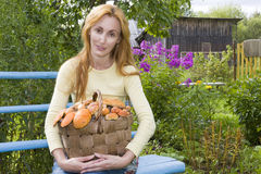 Basket, full mushrooms, and young woman-mushroom p Stock Photography