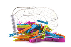 Basket Full Of Clothes Pegs Stock Image