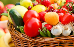 Basket full of organic fruit and vegetables Stock Images