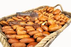 Basket full of patties isolate. Background Stock Photo