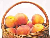 Basket full of peaches Stock Images