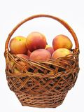 Basket full of peaches fruit Stock Photo