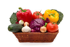 Basket full of peppers, onion, garlic, cucumber, cabbage, peas, tomatoes, kale Stock Image