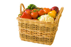 Basket Full of Produce. A wicker basket full of brightly colored produce Stock Photos