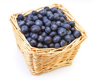 basket full of a ripe bilberry on a white background Royalty Free Stock Images