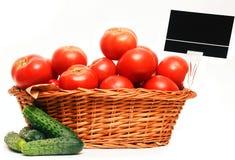 Basket full of tomatoes. Stock Photo