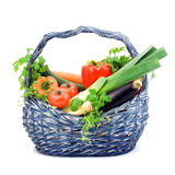 Basket full of vegetables and herbs. Basket full of fresh vegetables and herbs, clipping path Royalty Free Stock Images