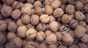 Basket full of walnuts for sale Stock Photography