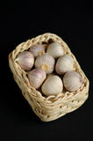 A basket of garlic. On a black background Royalty Free Stock Photos