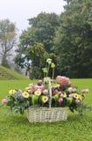 Basket with gerbera and rose flowers Stock Photos